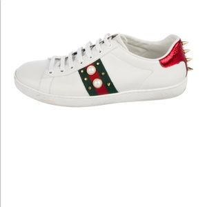 Gucci Spiked low-top sneakers.